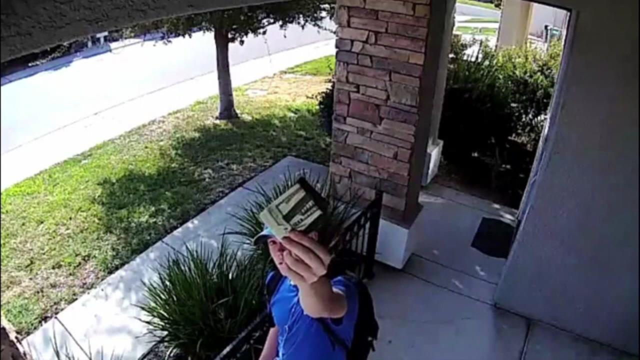 Young man returns wallet full of money and credit cards