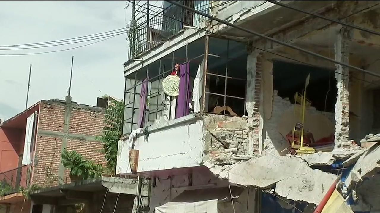 Residents in Mexico begin to clean up after quake