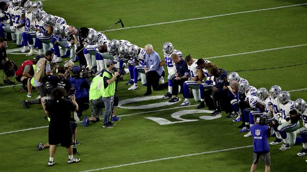 Dallas Cowboys kneel on field with owner Jerry Jones