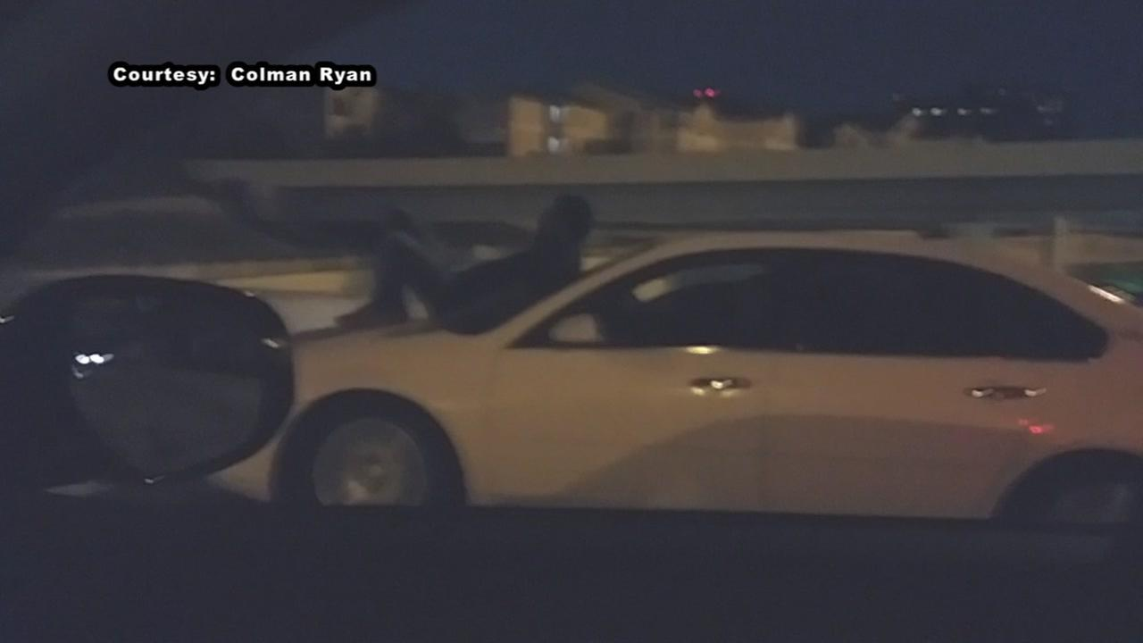 Man seen riding on car hood down Southwest Freeway