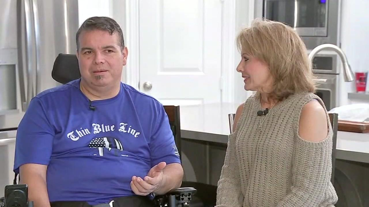 Officer who was shot by burglar is back at home with his family