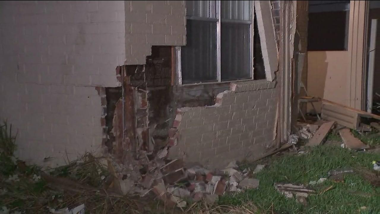 Truck slams into houses