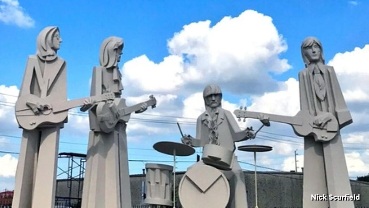 Giant Beatles statues on display at 8th Wonder Brewery
