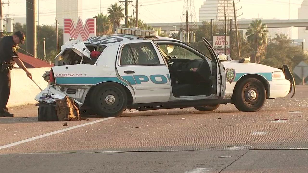 Pickup driver slams into 2 HPD cruisers on Hwy 59