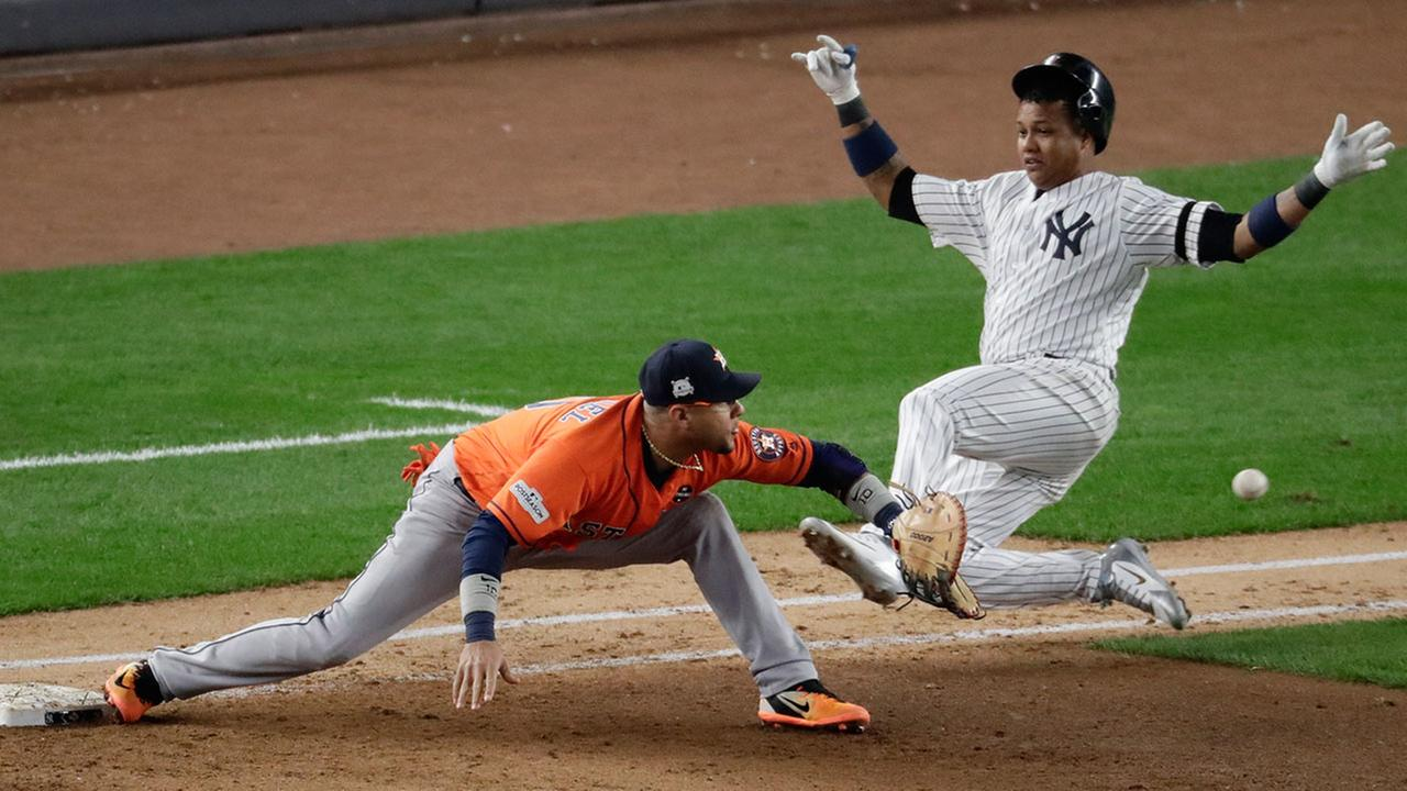 New York Yankees Starlin Castro is out at first as Houston Astros first baseman Yuli Gurriel takes the throw during the seventh inning of Game 4.