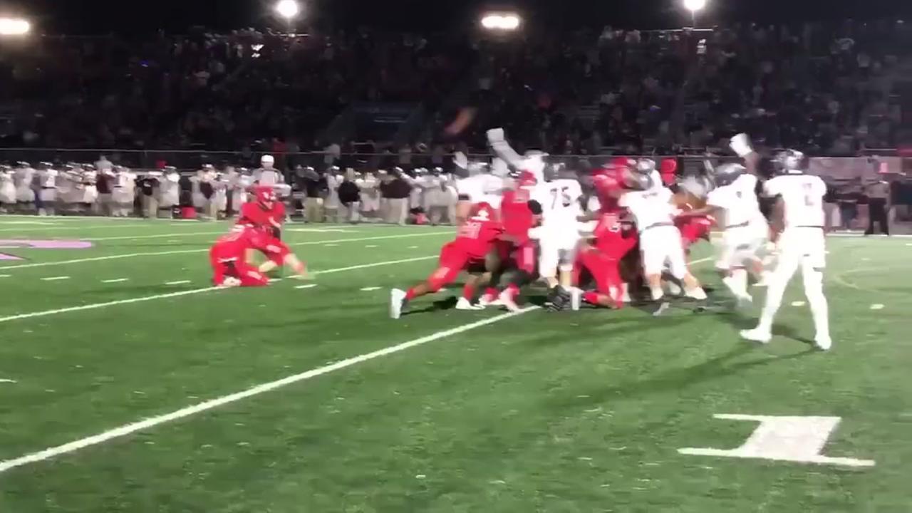 Female kicker seals the game for Dawson High School