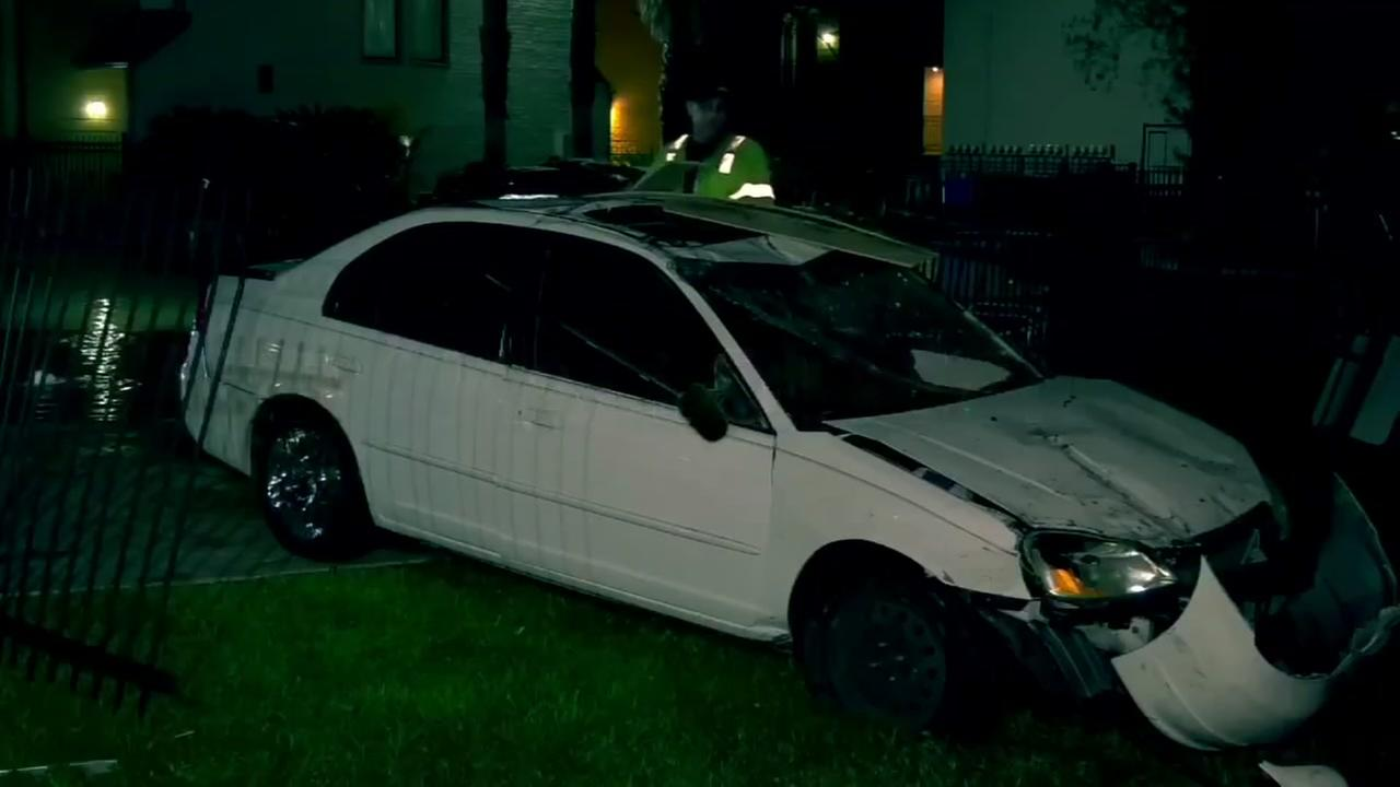 Woman crashes into building