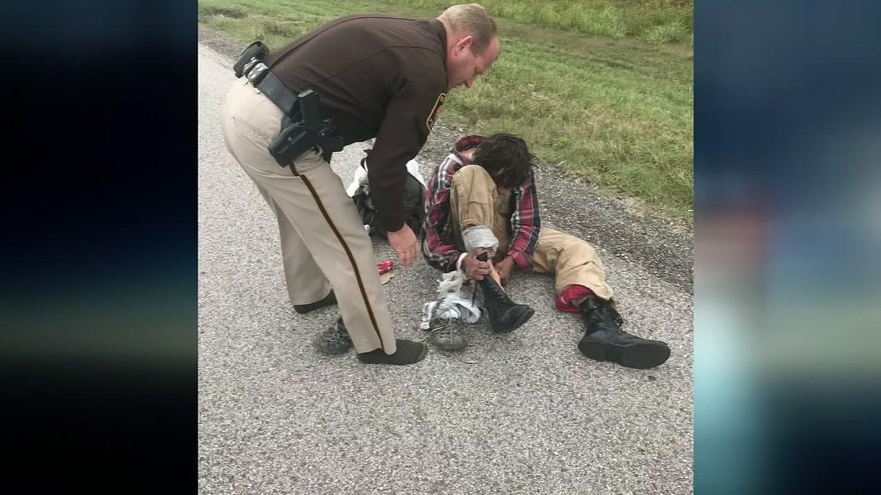 Sheriff gives homeless man boots off his feet