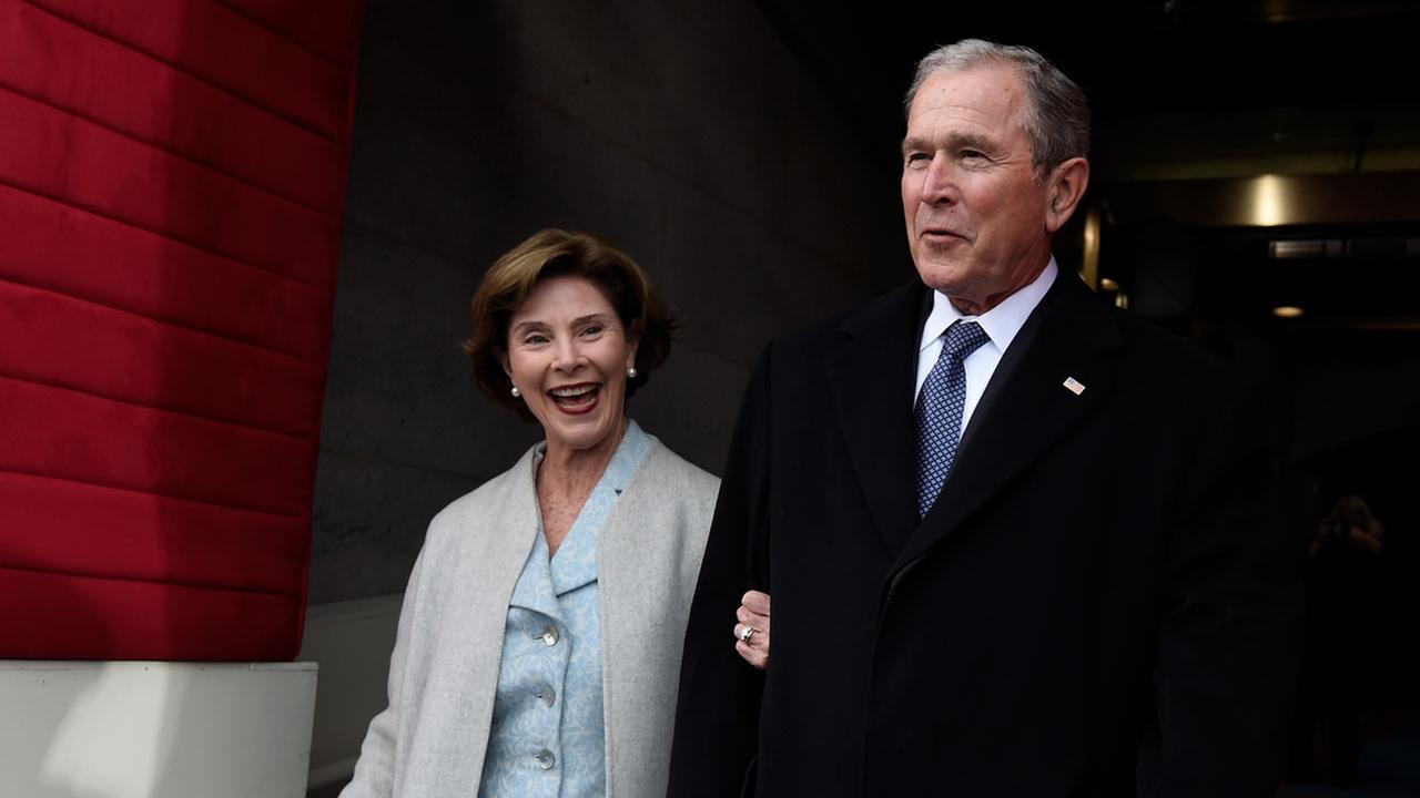 Former US President George W. Bush and First Lady Laura Bush arrive for the Presidential Inauguration of Donald Trump at the US Capitol in Washington, DC, January 20, 2017.