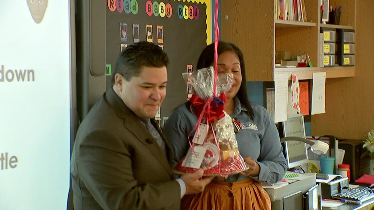 HISD surprises teacher of the month with a gift basket and a beemer for the month
