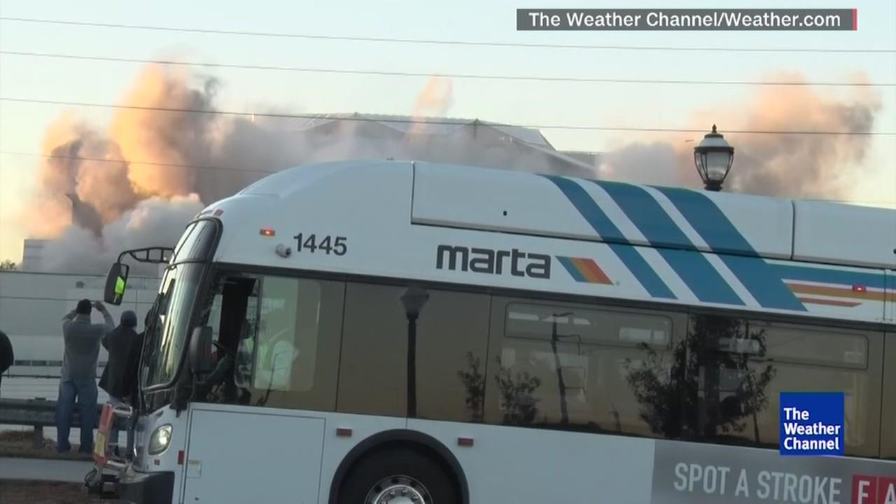 Bus photo bombs historic implosion