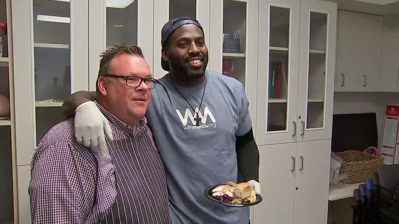 Whitney Mercilus serves Thanksgiving Dinner