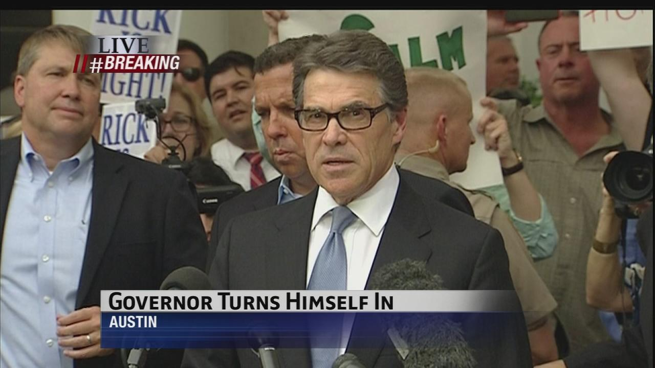 Gov. Rick Perry turns himself in