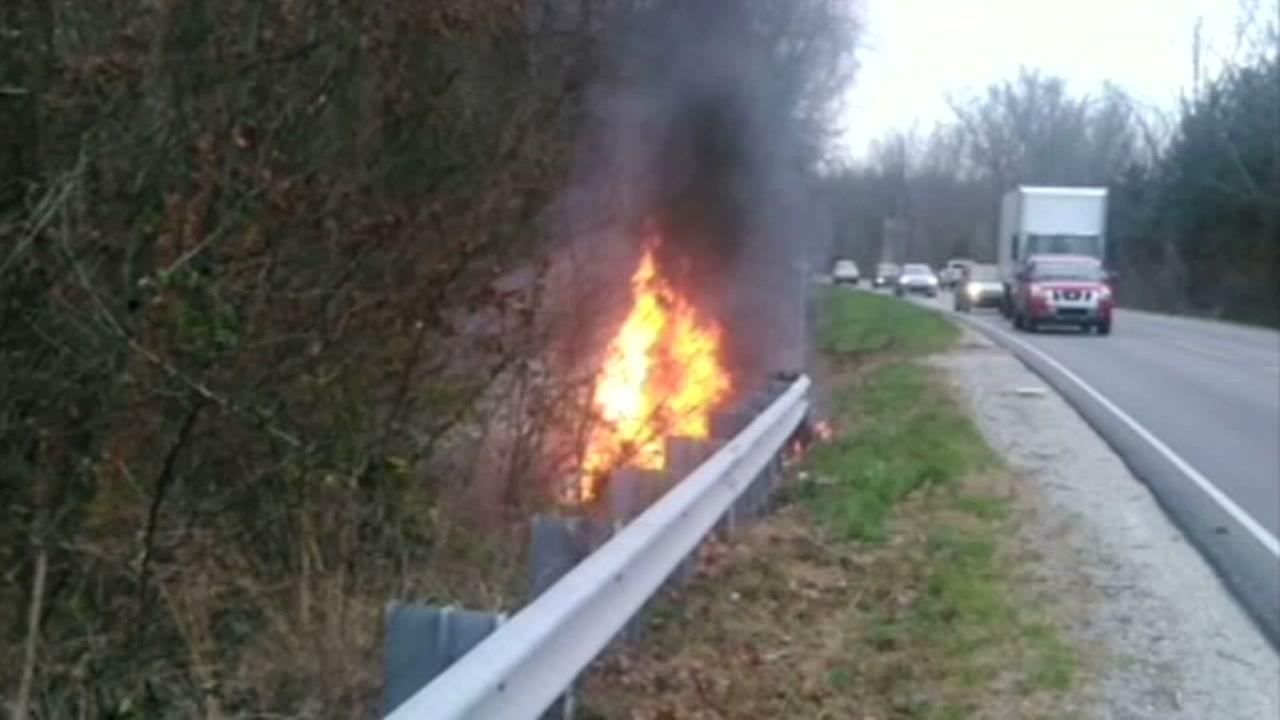 Three men pull passenger from burning car