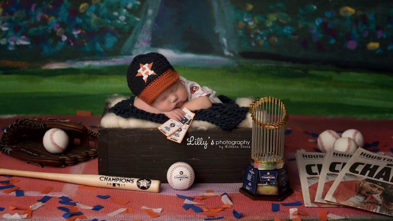 Baby born during World Series holds mini trophy in adorable photo shoot
