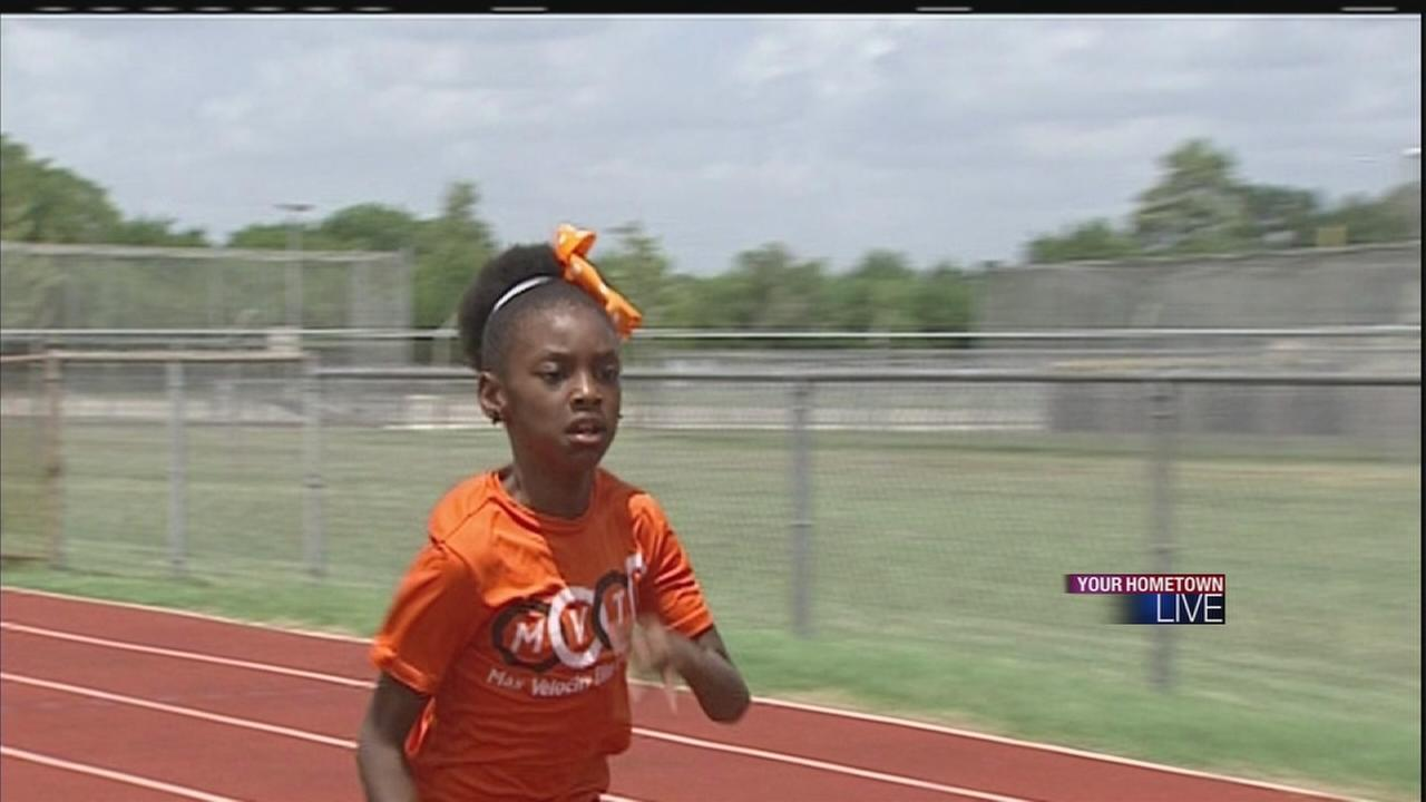Local 8-year-old holds national track record