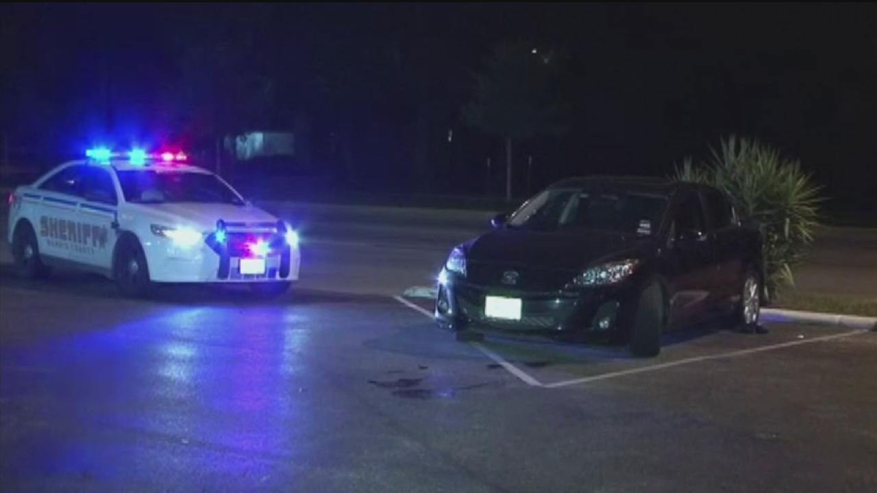 Man attacked while changing tire