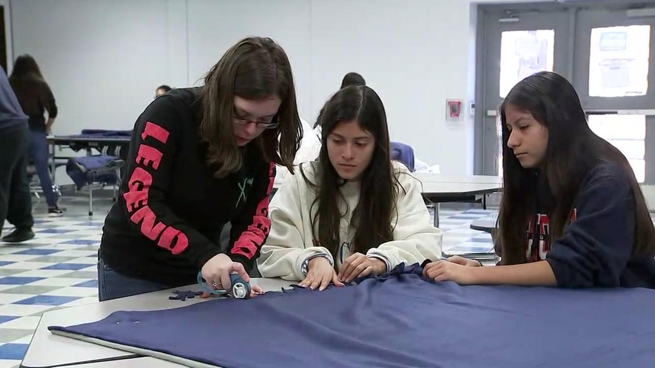 HS students knit blankets for the homeless