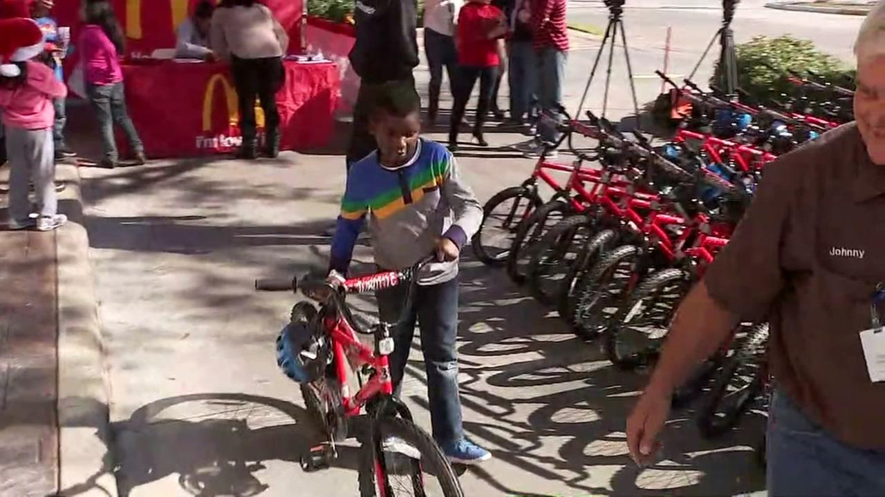 McDonalds gift kids with new bikes