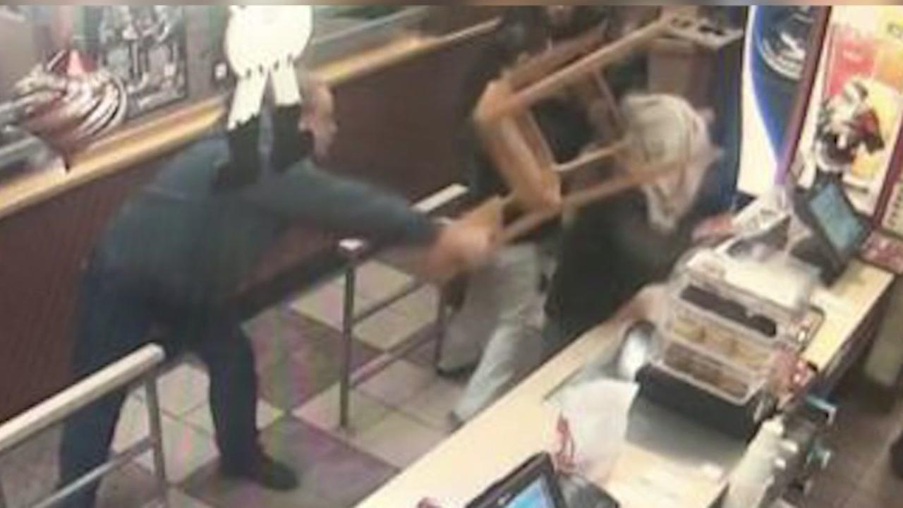Customer smashes robber with chair