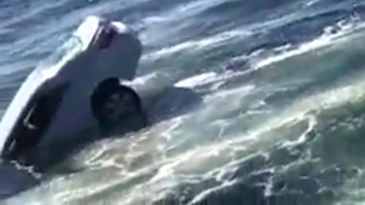 Man rescued sinking car