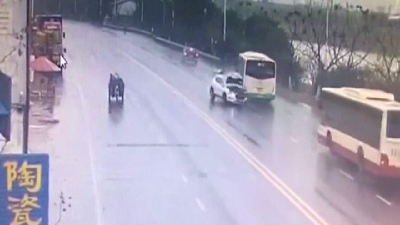 SUV crash sends Chinese bus into river