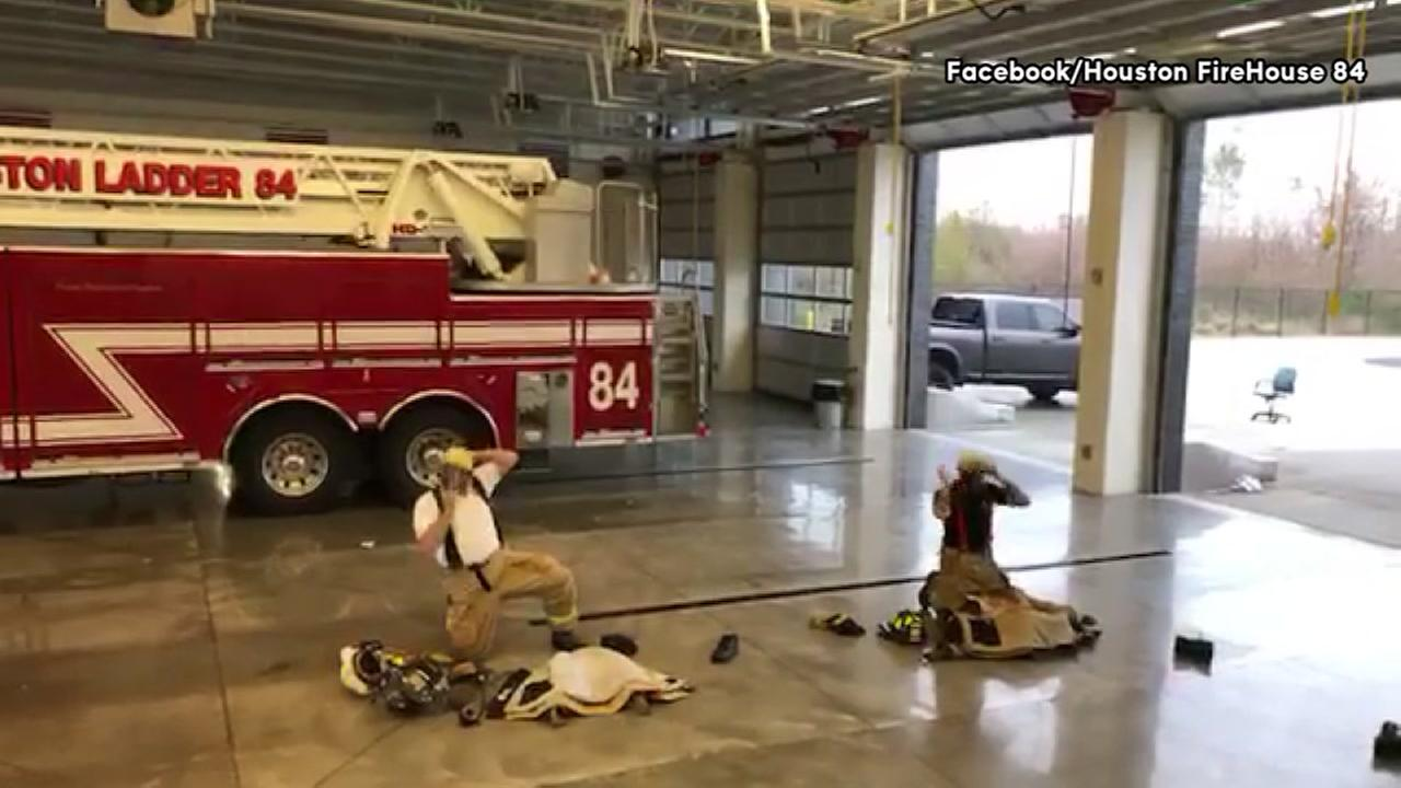 Cheif battles rookie to see who can suit up the fastest at Houston fire station