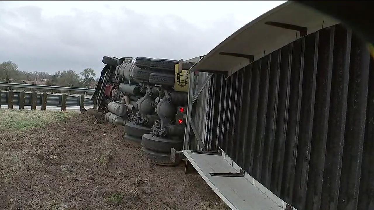 Big rig flips on slick roads
