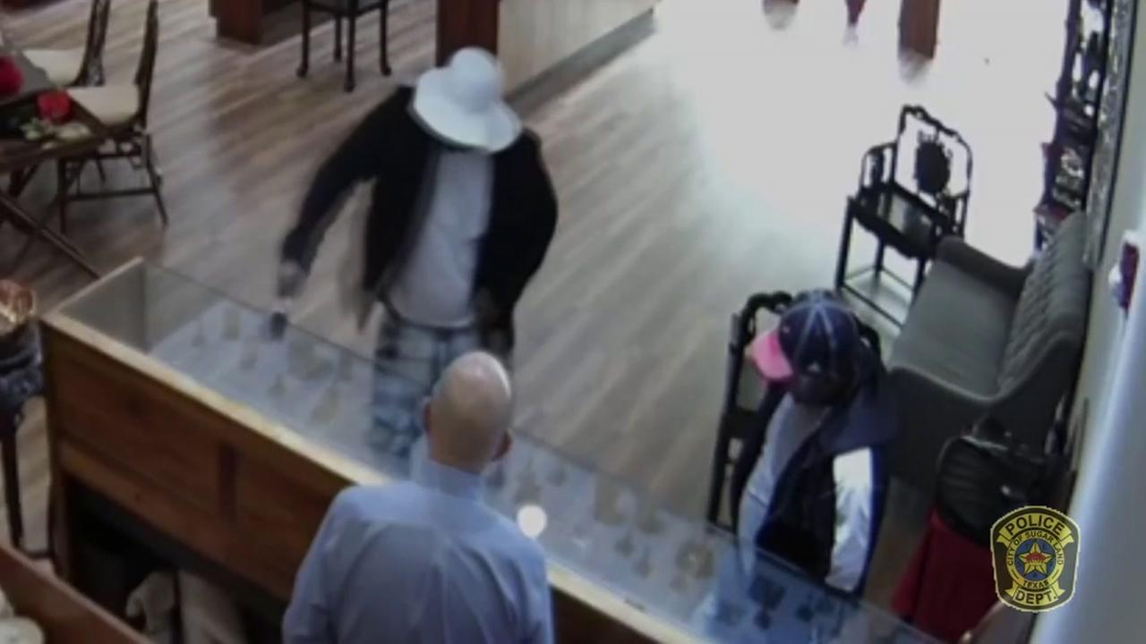 Surveillance video of two suspect smashing jewelry cases at Sugar Land store
