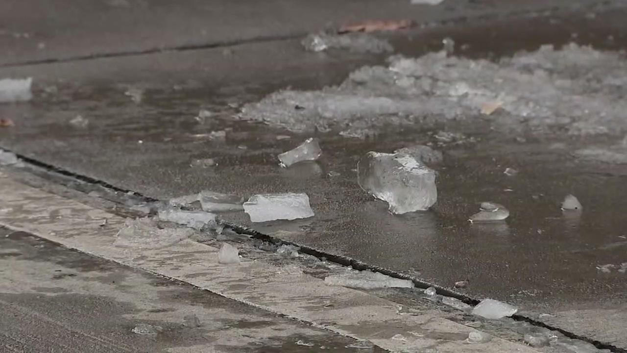 Chunks of ice fall from buildings in downtown Houston