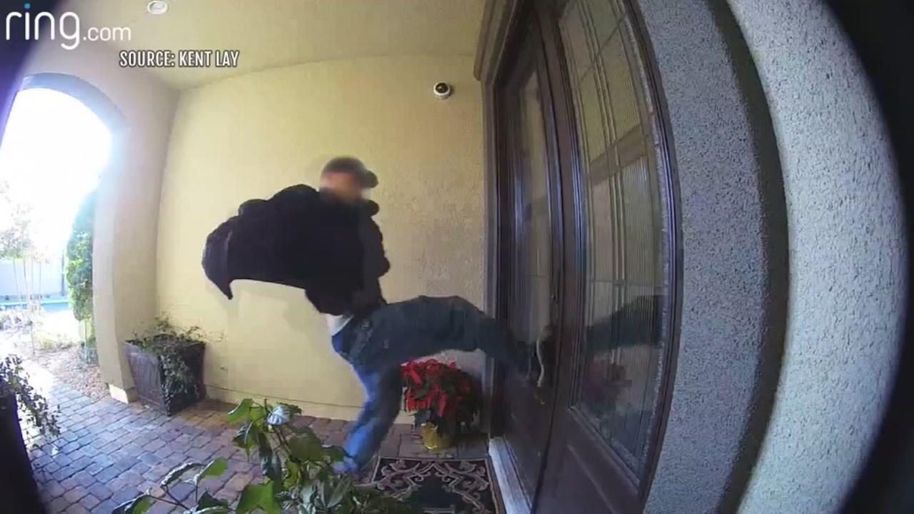 Man shoves door on cam