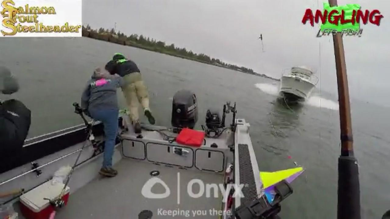 Harrowing video shows fishermen bail out of a small boat, seconds before boat plows over them