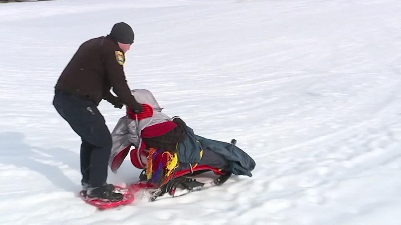Cops and firefighters take man sledding