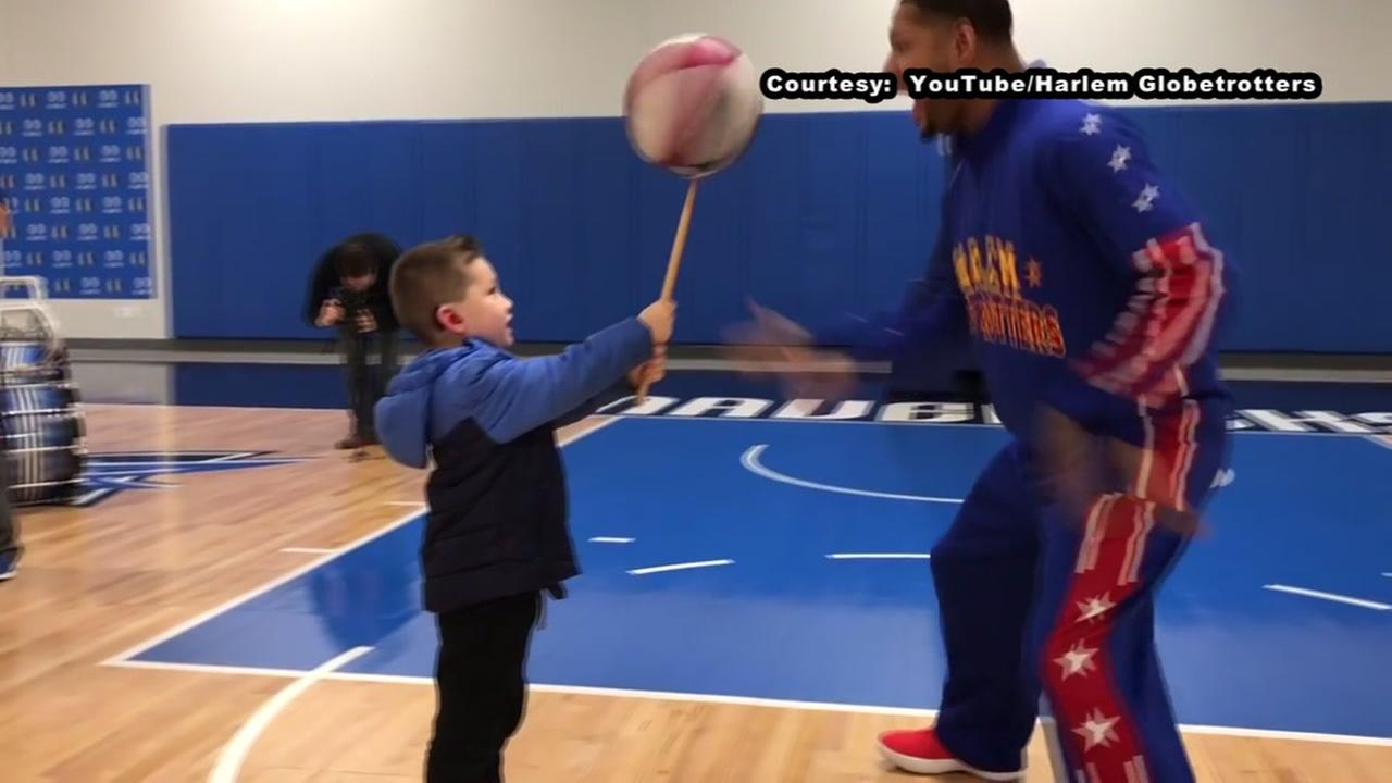 Boy surprised by Harlem Globetrotter after hearing for 1st time