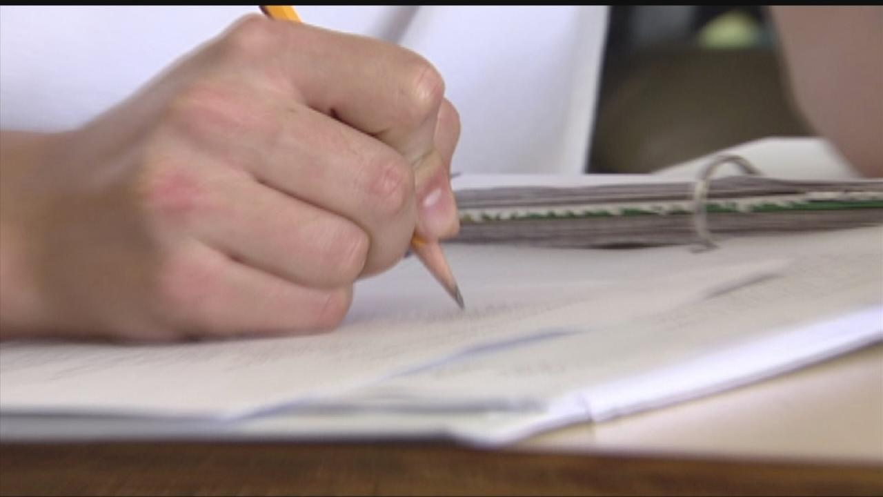 Teacher files suit over cheating scandal