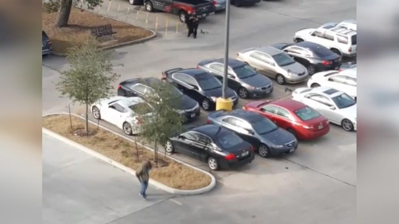 Witness captures video as officers close in on armed suspect
