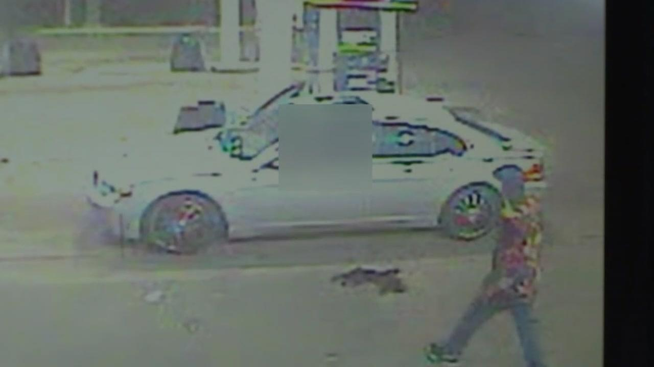 Surveillance video shows a woman struggle with the men who killed her outside a southwest Houston gas station.