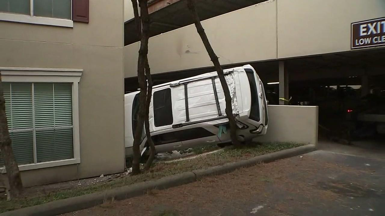 Womans vehicle falls off 3 story parking garage
