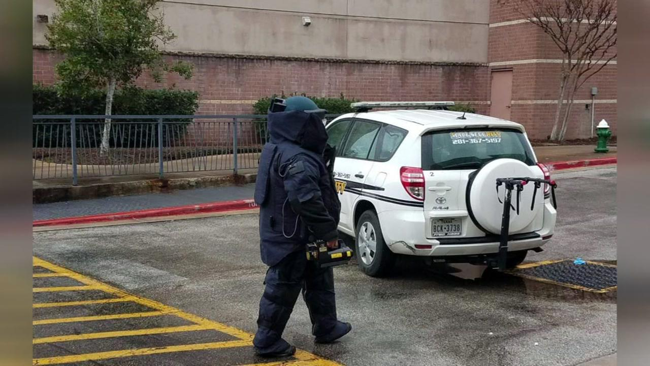 Two stores at Woodlands Mall evacutated after suspicious package found.