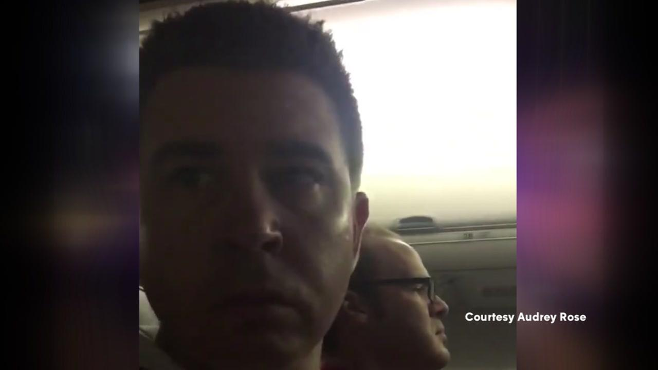 Woman surprises husband with pregnancy announcement on flight