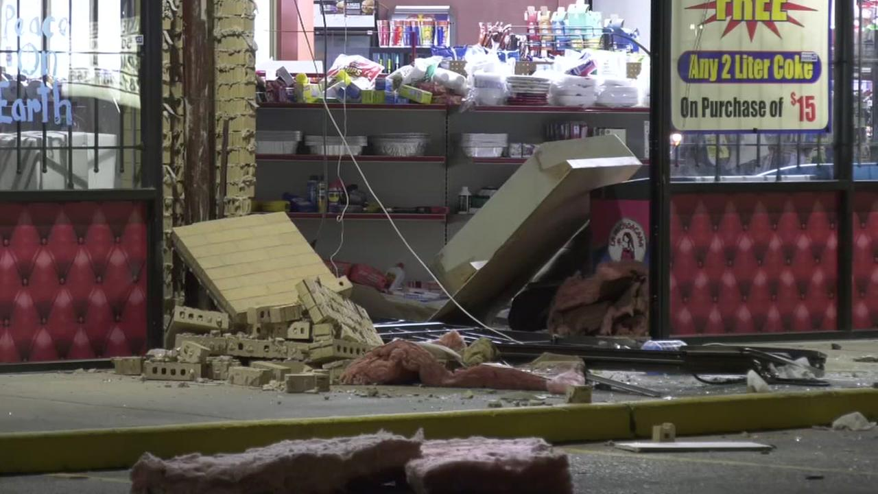 Thieves crash truck in store and steal ATM