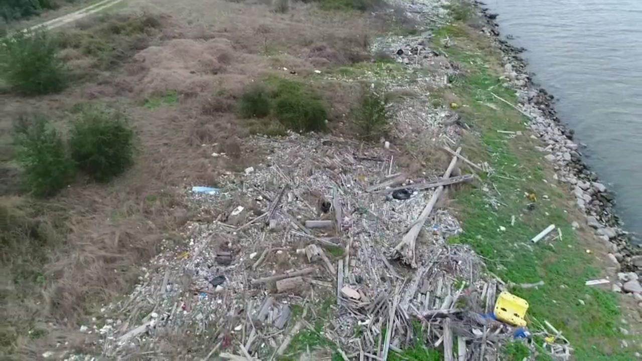 Large trash piles fill parts of Houstons Ship Channel