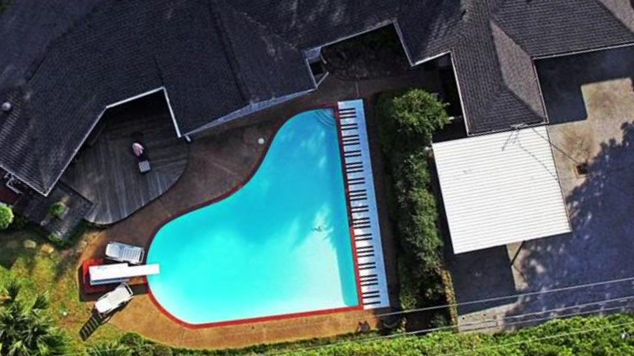 Home with piano shaped pool is up for sale