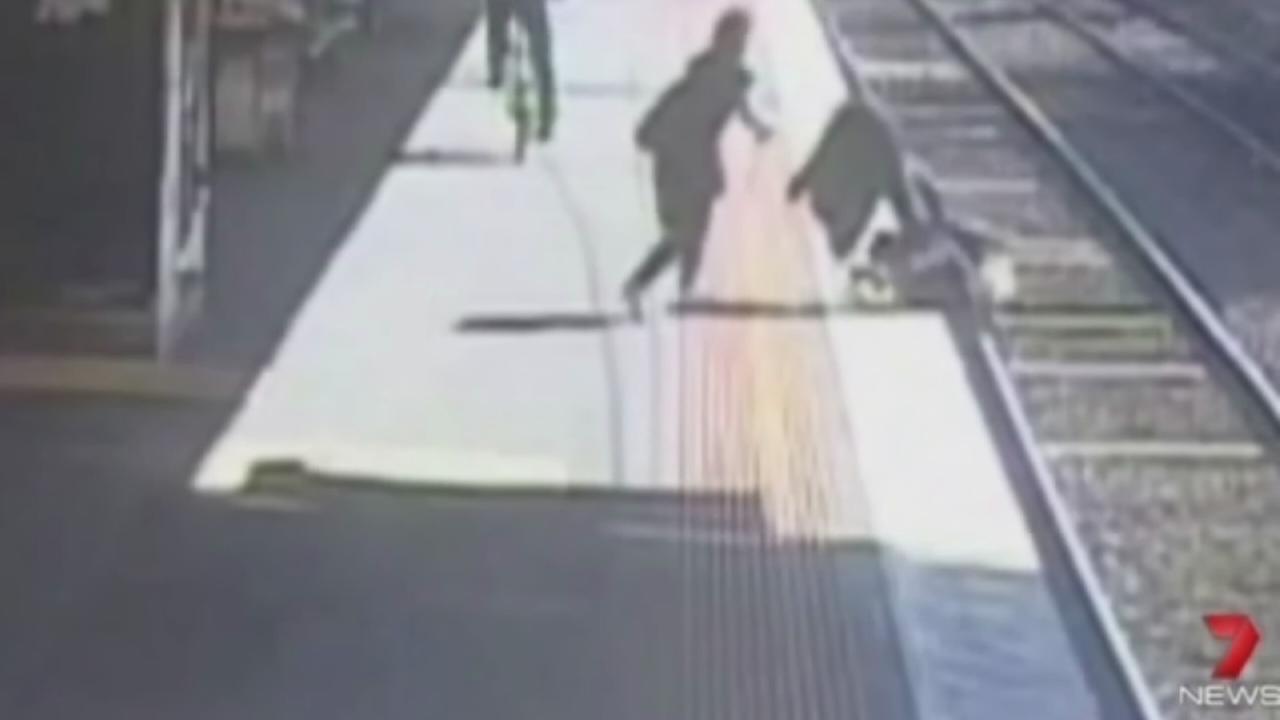 Stroller falls on tracks