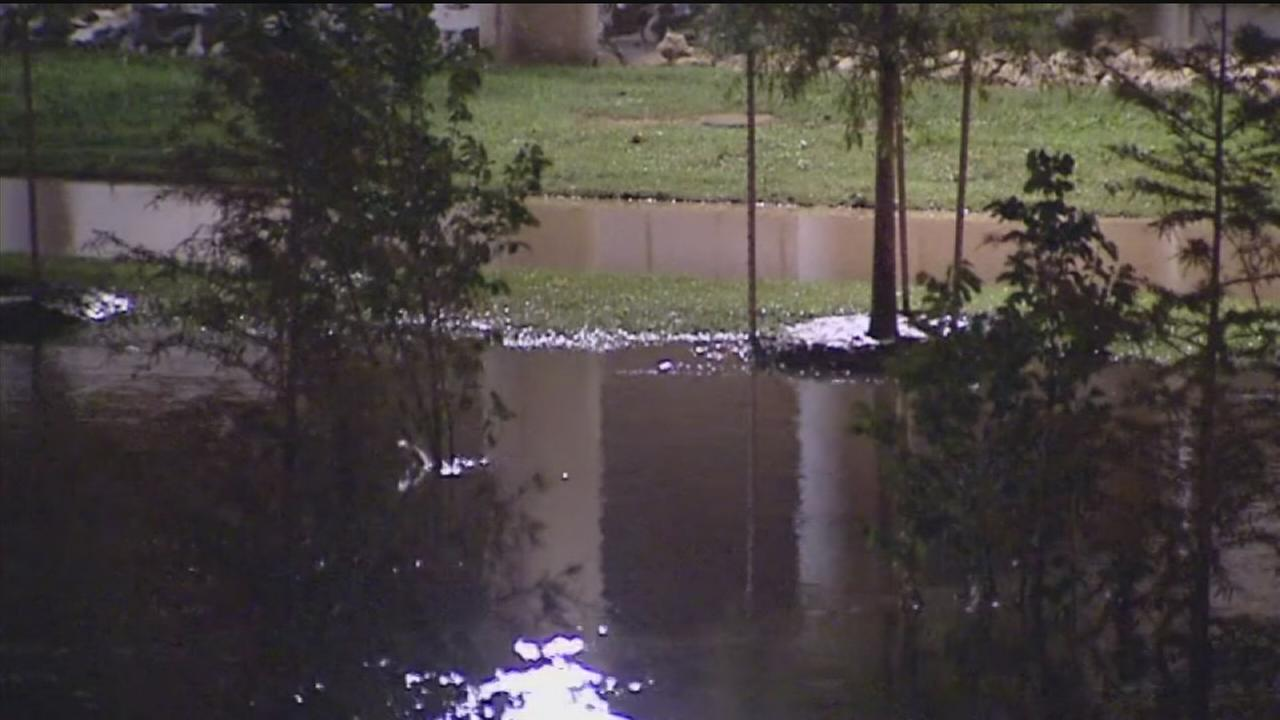 Rains saturate Houston streets, cause flooding