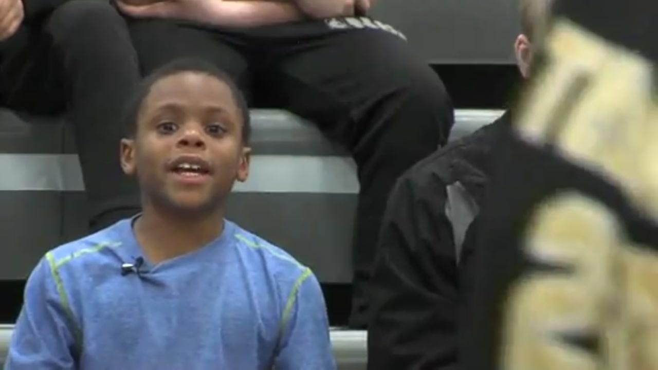 HS basketball team embraces special needs child