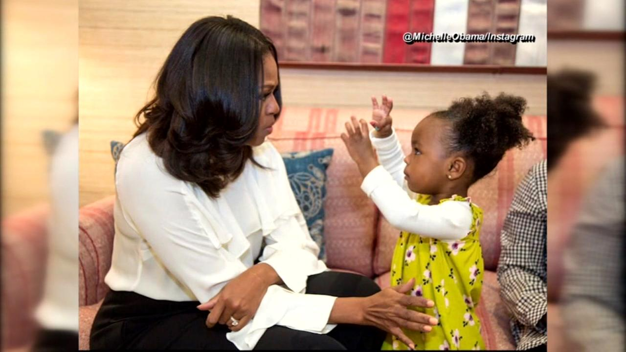 Michelle Obama dances with her youngest fan