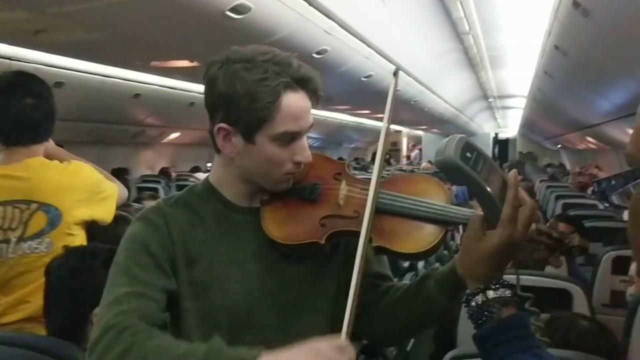 Stratford high school students play music on United flight