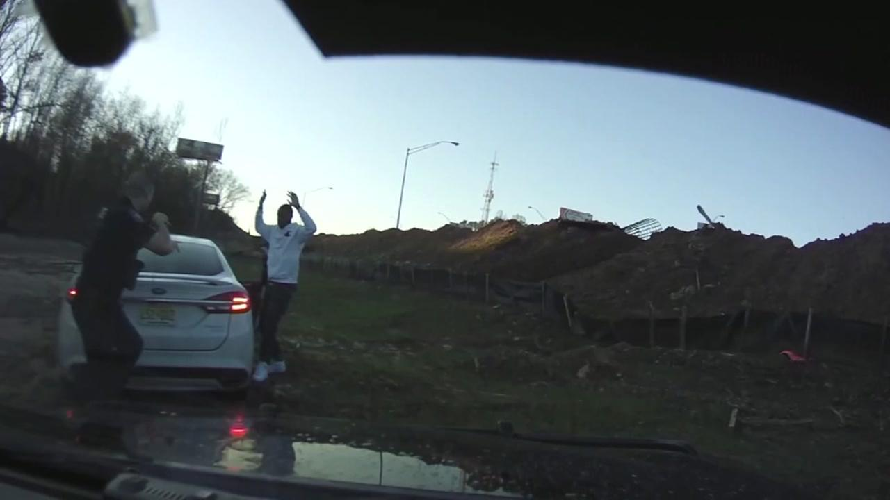 Dash cam video shows suspect take off in car with police officer