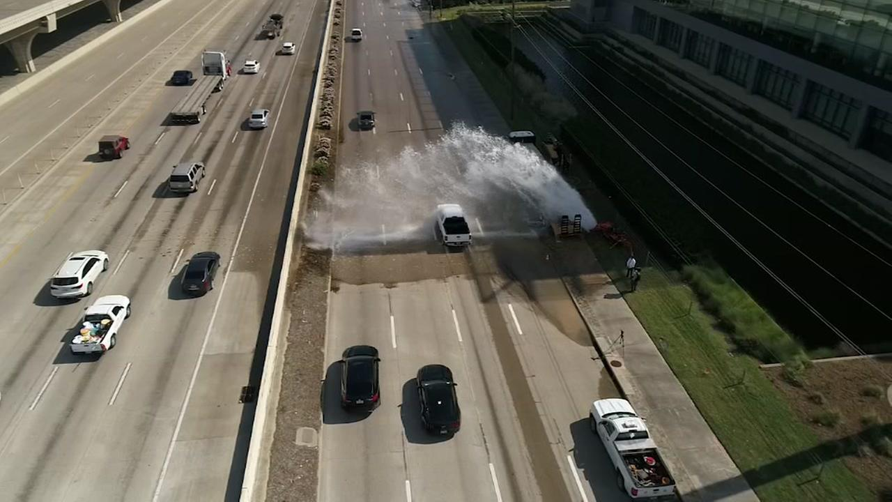 Busted waterpipe in Katy showers cars on freeway